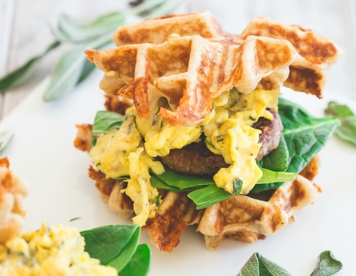 Herbed-Cheddar-Sausage-and-Egg-Waffle-Sandwiches_whmpg